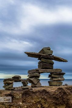 Inukshuk - Pinned by Mak Khalaf Beautiful Inukshuk from Cap Enrage New Brunswick. Travel Inukshukbeautifulbluecanadacap enragecloudsinuitnew brunswickrockrocksseaskysummertravelwaterCanadian landscapelandscapenorth by glinasmario Landscaping With Boulders, Garden Landscaping, Atlantic Canada, Prince Edward Island, New Brunswick, Cairns, Land Art, Outdoor Projects, Lawn