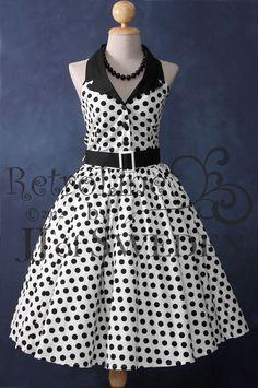 Polka dot patterned rockabilly dress. Designed handmade 50's Retro inspired halterneck M / L. $69.00, via Etsy.