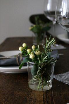 indigo fall table top | gardenista  seeded eucalyptus, rosemary, hypericum in short, squat vessels