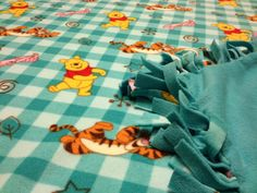 """Price: $35.00 Fleece blanket with Winnie the Pooh and turquoise backing (50"""" X 56""""). MADE BY KRIS"""