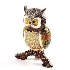 """Large Owl Trinket Box Item No. KB00533A01 $51.79 Outstanding! This owl is bejewelled and ready to watch over you and your things! He is made of pewter, hand enameled, and and plated with shiny gold. His sparkling crystals were hand placed. This wise owl looks great on any bookshelf!"""