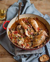 """A French classic that never seems to go out of style, this dish combines mushrooms and chicken in a tomato and white-wine sauce. The name, literally """"hunter's chicken,"""" harks back to a time when game birds and mushrooms from the woods were a natural autumn combination.Plus: More Chicken Recipes and Tips"""