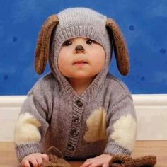 Cute baby dressed in puppy sweater