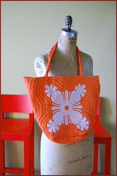 Hawaiian quilt tote  Looks like you have to go to Hawaii to get this cheerful tote. Too bad- love the color