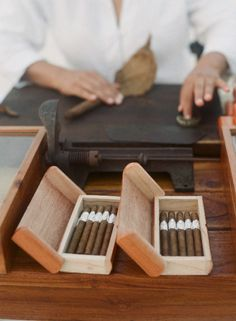 cigar bar at cocktail party or wedding reception with professional roller