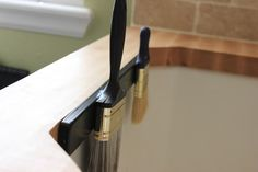 Magnetic knife strip on utility sink serves many purposes...