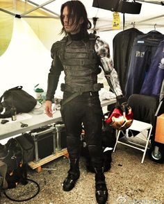 Sebastian Stan is Bucky Barnes holding the helmet of Iron Man.
