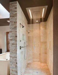 Doorless Shower Designs Teach You How To Go With The Flow - any space involving water and moving air (e.g., through the doorless doorway) runs a high risk of being chilly. Combat this by installing a heat lamp or radiant heated flooring.