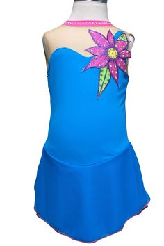 http://www.sk8gr8designs.com Beach surfer figure skating dress, aqua lycra with a hand painted hologram flower in front and back.