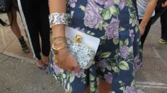"""""""Man Repeller"""" Leandra Medine sports a hard shell clutch by Reece Hudson. Her front-row seat to New York Fashion Week underscores her influence among brands and fans."""