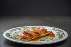 home made ravioli stuffed of shrimps an sea bass in cherry tomatoes sauce.