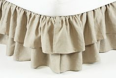 This would be the one frilly thing in the room -anne fabricl is earthy to offset the frill - Double Ruffle Bedskirt, Natural on OneKingsLane.com