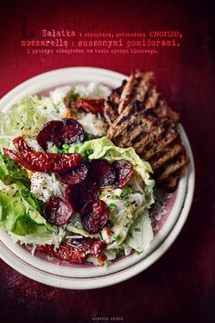 Salad with toasted flatbread, chorizo, mozzarella, ricotta, parmesan and sun-dried tomatoes