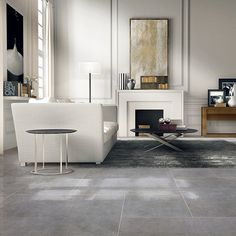 This elegant lounge features a beautiful limestone effect porcelain tiled floor in Pierre Blue Stone Look Tile, Gray Polish, Polished Porcelain Tiles, Limestone Flooring, Ceramic Wall Tiles, Style Tile, Wall And Floor Tiles, Floor Decor, Tile Design