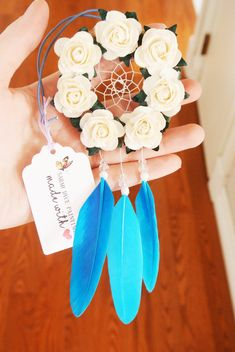 This pretty royal blue flower dreamcatcher makes a unique gift, or treat yourself! The perfect size for a cute car dreamcatcher, interior car accessory, rearview mirror charm, or boho nursery decor, this piece has an attached elastic at the top for easy installation over your cars
