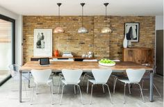 Contemporary Dining Room with Metallic Track Lights