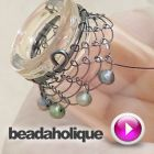 Tutorial - Videos: How to Add Beads to a Wire Net around a Bottle | Beadaholique