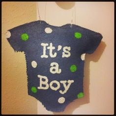 this one is for a boy, but I may have to try this!!!  Baby burlap hanger idea for baby showers