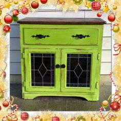 This distressed oak cabinet is painted in a bold CeCe Caldwell Hill Top Green chalk paint.The wood top and inside are refinished in a dark rich expresso stain.