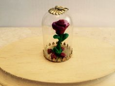 Beauty and the beast inspired rose under glass necklace. Made from polymer clay and glazed.