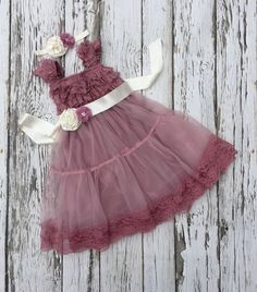 A personal favorite from my Etsy shop https://www.etsy.com/listing/275127626/flower-girl-dress-dusty-rose-girls-lace