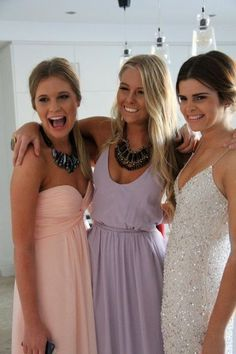 simple dresses, statement necklaces, simple hair. Want the purple dress