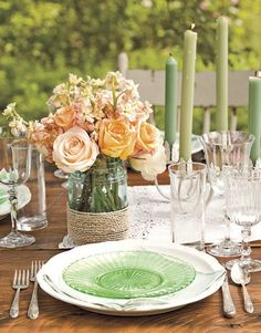 Outdoor table setting with creative mason jar vase.