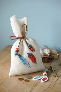 This would be a great favor for a Thanksgiving party. If the cross stitch takes too long, stamp design leaves or feathers onto the fabric.