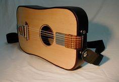 Traveler's Guitar That Folds In Half by Shlomi Daniel and Uri Nir