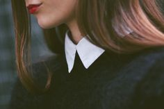 Red lips, a collared shirt and a black jumper