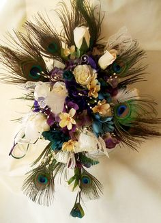 MICHIGAN - Peacock Wedding Bouquet Ivory Gold Teal Purple silk flower feather Bouquet Peacock Bride Custom made. $165.00, via Etsy.