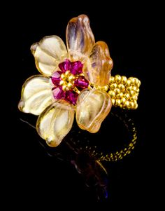 Fabulous and stunning ring with Fuschia Swarovski bicones in the centre, mingled with leaf beads and a gold coloured seed bead band