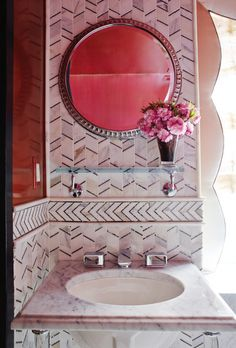A mix of graphic tile patterns in a powder room, designed by Young Huh for the 2014 Kips Bay Show House.