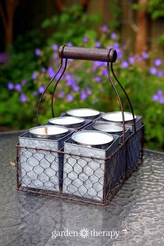 DIY Citronella Candles make them in soup cans and display in an antique milk crate - six burning candles will make sure there is not a mosquito to be found!