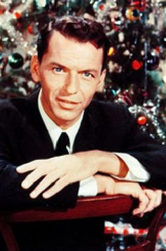 Frank Sinatra in front of the Christmas Tree