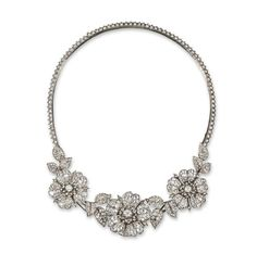 HomeLot  Jewellery - Lot 1382  A Victorian diamond set floral necklace, designed as three graduated wild rose heads