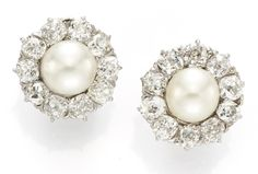 A Pair of Natural Salt Water Pearl and Diamond Ear Clips. Available at   FD Gallery. www.fd-inspired.com