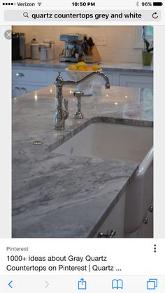 Kitchen countertop in new house Quartz grey with white cabinets