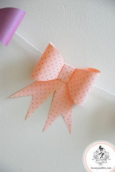 DIY Paper Bow Garland   *Jen here* .. how cute would this be for a little girls party?? Or different occasions in seasonal papers???