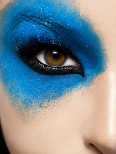 Heavy eye liner and shimmering blue.