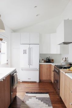 Fridge with single door pantry to the left and cabinets above