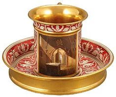 A Sèvres porcelain cabinet cup and saucer painted by Jean-Claude Rumeau in the Gothic taste with the tomb of El Cid