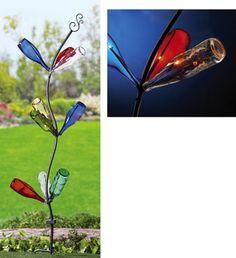 Solar Garden Bottle Tree  http://www.collectionsetc.com/Product/garden-bottle-tree-solar-lawn-stake.aspx/_/Ntt-bottle-tree