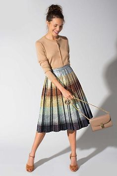 It's way easier than you think to wear fall 2015's metallic trend into work - try a bold, pleated midi skirt like this one with a tucked-in sweater or cardigan. Cute, right? Click for 7 more outfit ideas we love!