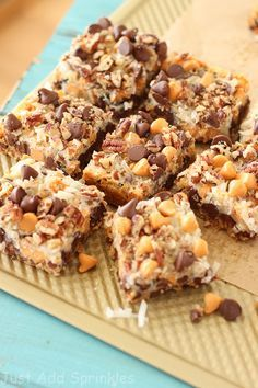 These bars have everything you want in flavor & texture. Lots of chocolate chips, butterscotch chips, sweetened coconut flakes and pecans go into these bars Seven Layer Cookies, Christmas 7 Layer Cookie Bars, Christmas Cookies, Christmas Baking, Christmas Desserts, Christmas Traditions, Homemade Christmas, Holiday Baking, Christmas Treats