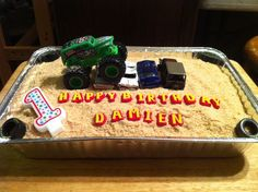 Monster Truck Birthday Cake I made this for my grandson's first birthday. He is fascinated with trucks and tires.  I used crushed vanilla wafers for the dirt. Very easy to make.