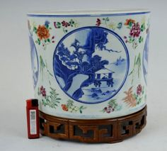 19th C Chinese Enamel w B & W Porcelain Planter; underglaze blue roundels illustrate the 4 noble professions; custom hardwood stand. Provenance: Virginia collector circa 1950. Auction est: $2000-$3000.
