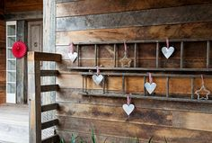 This would be cute with a smaller ladder and some pictures hanging on the rungs.
