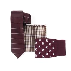 Start with our horizontal Institute Stripe tie (sure to warrant second glances). Grab a complementary pair of socks and silk pocket square, both maximizing on the tie's deep burgundy base. Try with a navy suit, or a blue shirt and denim for a cool but casual look. www.TheTieBar.com