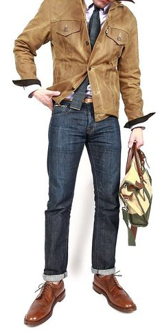 I really love this look. The suede jacket, squared off tie, and cuffed denim give it an old school rugged vibe. The fit, layering, and styling make it modern. Love it!